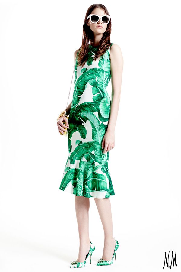 Bring the tropics home with this banana-leaf inspired, sleeveless midi dress by Dolce & Gabbana. Pair with matching pumps and gold accessories for a resort look.