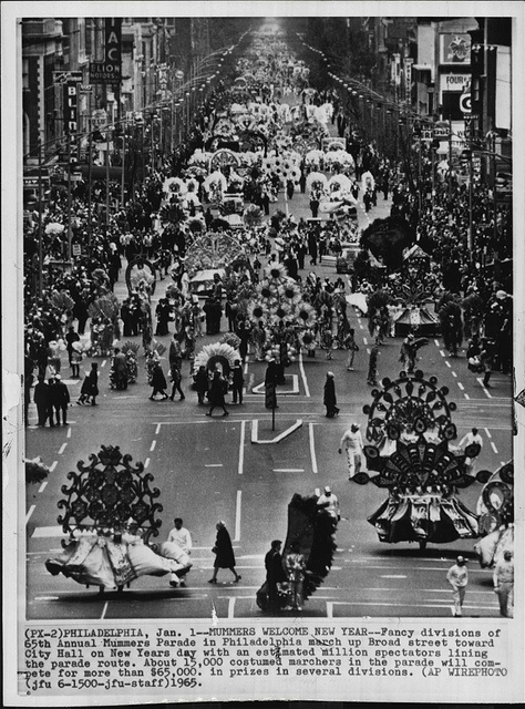 AP Wirephoto of the 1965 Philadelphia Mummers Parade. Image of the Fancy division marching north toward City Hall.