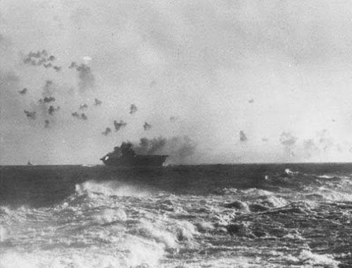 The carrier USS Enterprise (CV-6) under aerial attack during the Battle of the Eastern Solomons.