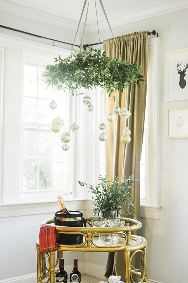 We love this hanging wreath with Christmas ornaments created by Caitlin Moran of Style Within Reach. She explains how she made it on The Home Depot Blog.