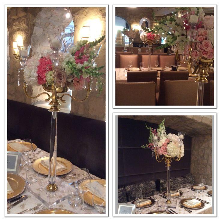 Beautiful flower arrangement on our Gold Candelabras at the Auberge Du Pommier Restaurant in Toronto.