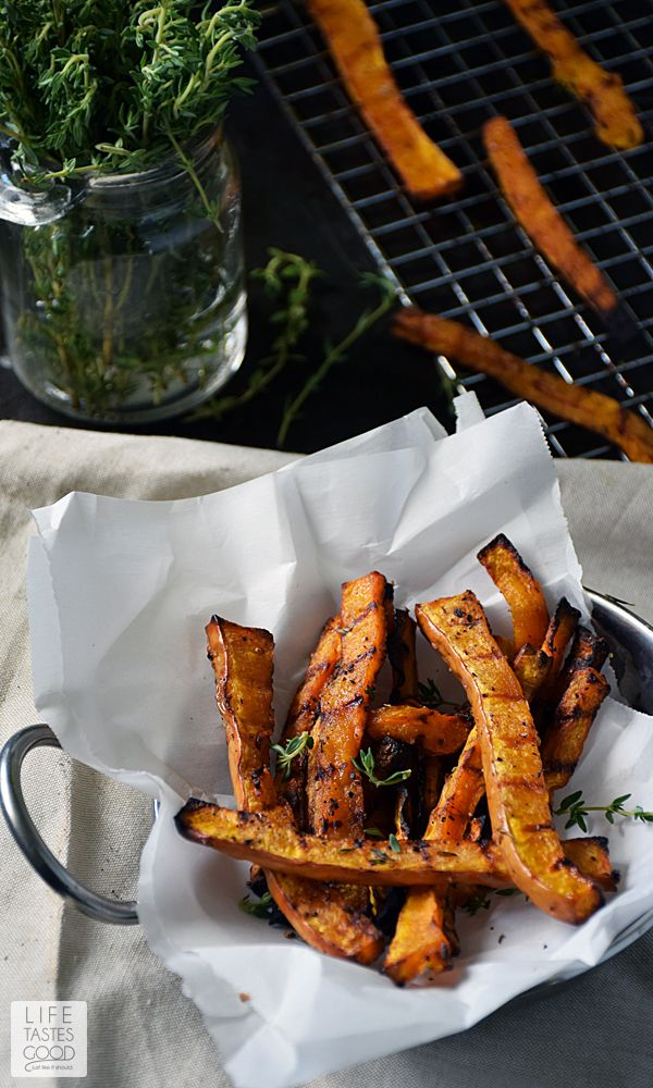 Honey Baked Butternut Squash Fries | by Life Tastes Good are a sweet and savory side dish perfect for fall! The subtle honey flavor combined with the sweet, nuttiness of butternut squash and a touch of thyme for that savory flare, will have you begging for more! #LTGrecipes: