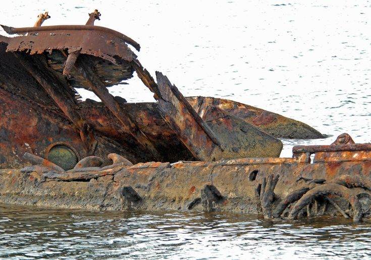 The wreck of USS Utah at Pearl Harbor....passed this every time we went to on load at the weapons pier in Pearl; it's not a commissioned ship in the US Navy anymore (like the Arizona), but you still have attention to starboard when you pass her.
