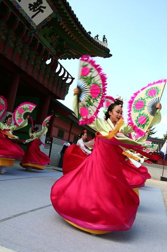 Buchaechum - A traditional form of Korean dance also called a fan dance, usually performed by groups of female dancers. Many Koreans use this dance during many celebrations.