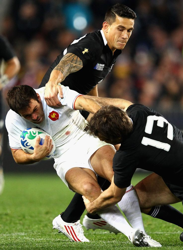 Morgan.Parra of France is tackled by Sonny Bill Williams and Conrad Smith of the All Blacks during the IRB 2011 Rugby World Cup Pool A match between New Zealand and France at Eden Park on September 24, 2011 in Auckland, New Zealand.