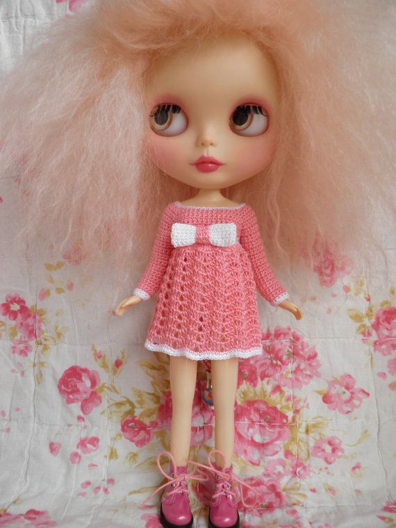I love the pink of her face, lips, and hair.  The dress is darling!