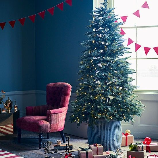 Blue Christmas living room with red armchair | Living room decorating | Homes & Gardens | Housetohome.co.uk