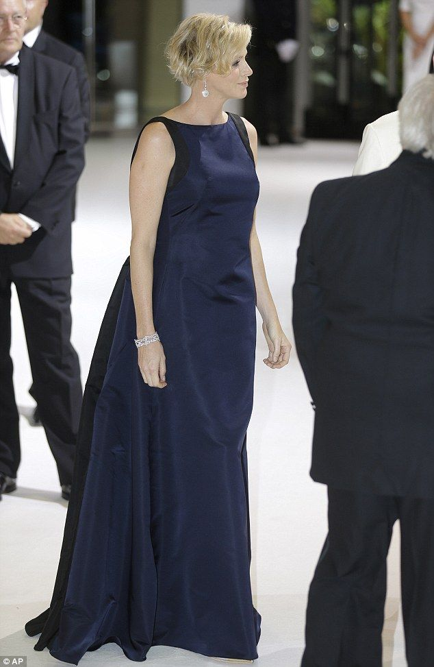 8/1/14. Stunning: The expectant mother's baby bump is slightly visible as she does the rounds at the glamorous event
