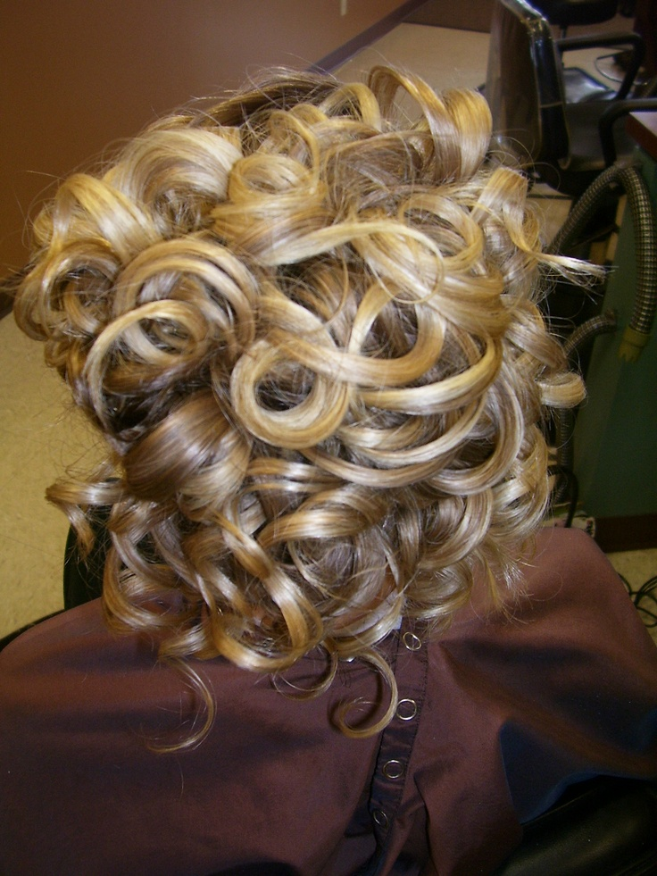 glossy, blonde updo style for prom or wedding. Lots of curl and texture. Hair by Annifaye.
