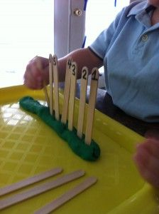 5.2.3 Numerals from 1 to 10: Write the numerals from 1 to 10 on sticks. Give some (or all) of these to a child, with some Play Doh, to make a sequence.