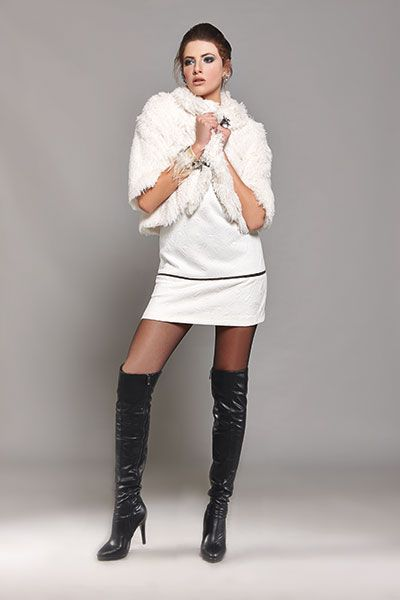 In a total white dress and heeled leather boots you can look nothing less than an ultra chic lady!