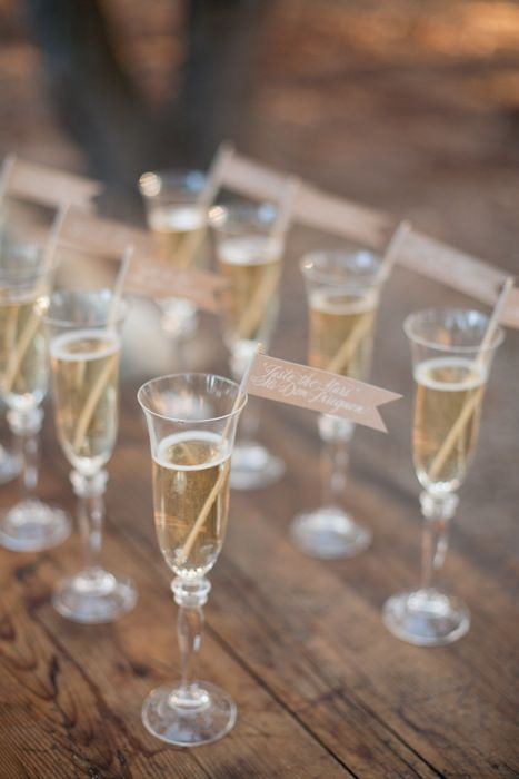 Champagne flutes with kraft paper flags.
