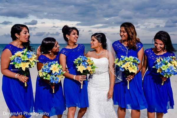 Beautiful short cobalt blue bridesmaid dresses and blue and yellow floral bouquets | Playa Del Carmen, Mexico Wedding by DreamArt Photography | Maharani Weddings