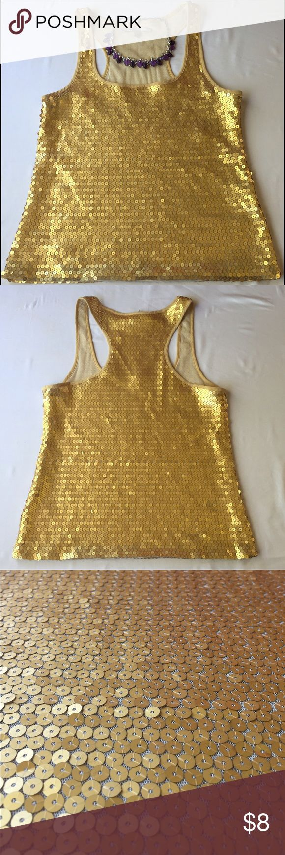 $$ Old Navy Gold Sequin Tank Top, SM Catch eyes with this Old Navy Gold Sequin Tank Top, SM. Great for a party or just a night out, this tank is sure to make you sparkle ✨ In great condition, no defects and comes from a smoke-free environment. Old Navy Tops Tank Tops
