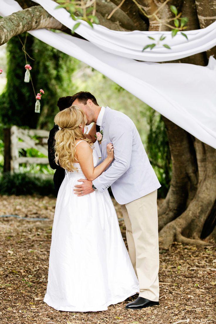 Photography: Calli B Photography - callibphotography.com.au Ceremony: The Barn, Flagstone Creek - www.thebarnandscottysgarage.com.au Wedding Dress: By Bride's Mother - N/A   Read More on SMP: http://www.stylemepretty.com/australia-weddings/queensland-au/2013/12/10/toowoomba-diy-wedding/