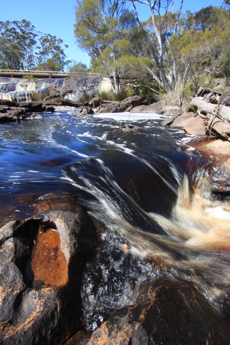 Fernhook Falls is located along the Deep River which is one of the main tribuaries of the Walpole and Nornalup Inlets. It is situated in the Mount Frankland National Park, part of the Walpole Wilderness Area about forty kilometres north of Walpole.