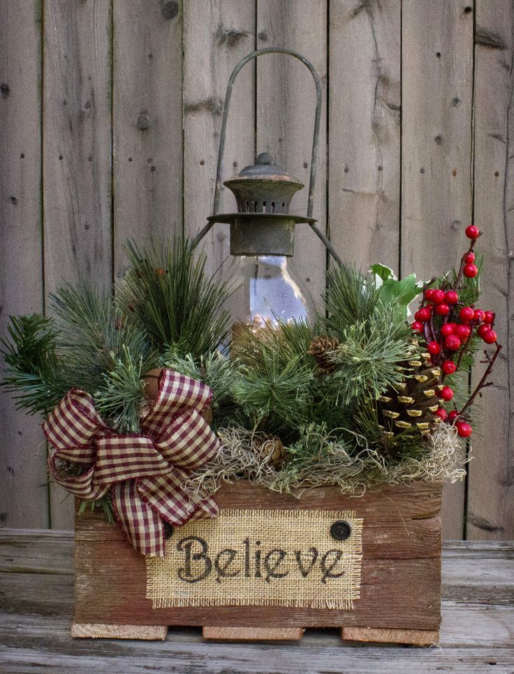 "This gorgeous piece is featured in the Country Sampler Magazine! Reclaimed barn wood box 12""x12""x16"", 16"" black lantern with battery-operated timer candle, country greens, berries, pine cones, rusty b"