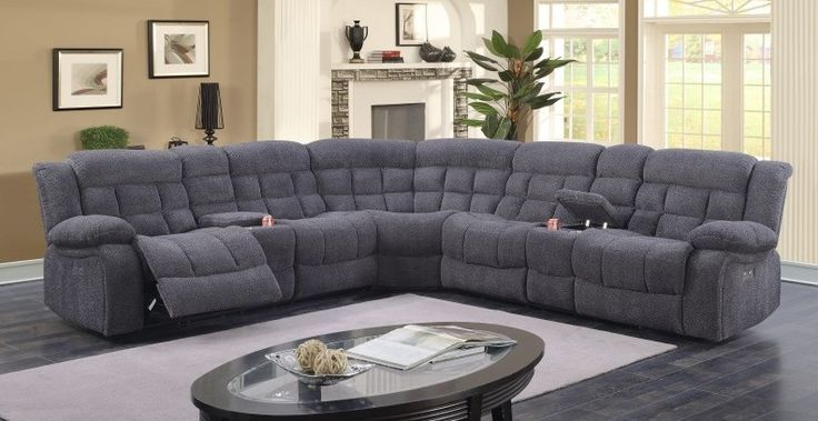 "3 pc Adriana collection grey chenille fabric upholstered power motion sectional sofa.  This set features power motion recliners with drink consoles and corner wedge.  Measures 120"" x 120"" x 41"" H.  Some assembly required."
