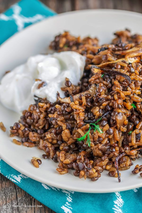 Mujadara Recipe | The Mediterranean Dish. This simple lentils and rice recipe garnished with crispy onions is a signature Middle Eastern Dish that makes for a healthy flavor-packed feast. Vegan, Gluten Free. Check out the easy step-by-step photo instructions at The Mediterranean Dish.