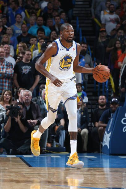 Kevin Durant of the Golden State Warriors handles the ball against the Oklahoma City Thunder on November 22 2017 at Chesapeake Energy Arena in...