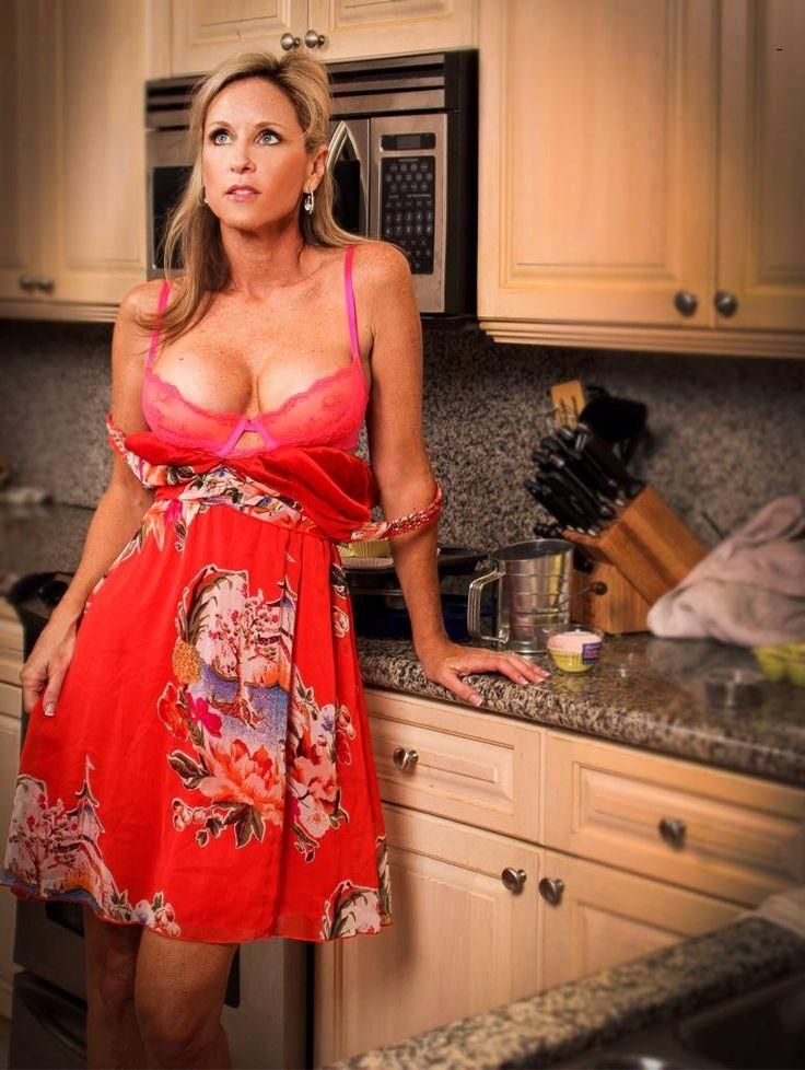 mature women in kitchen covered up
