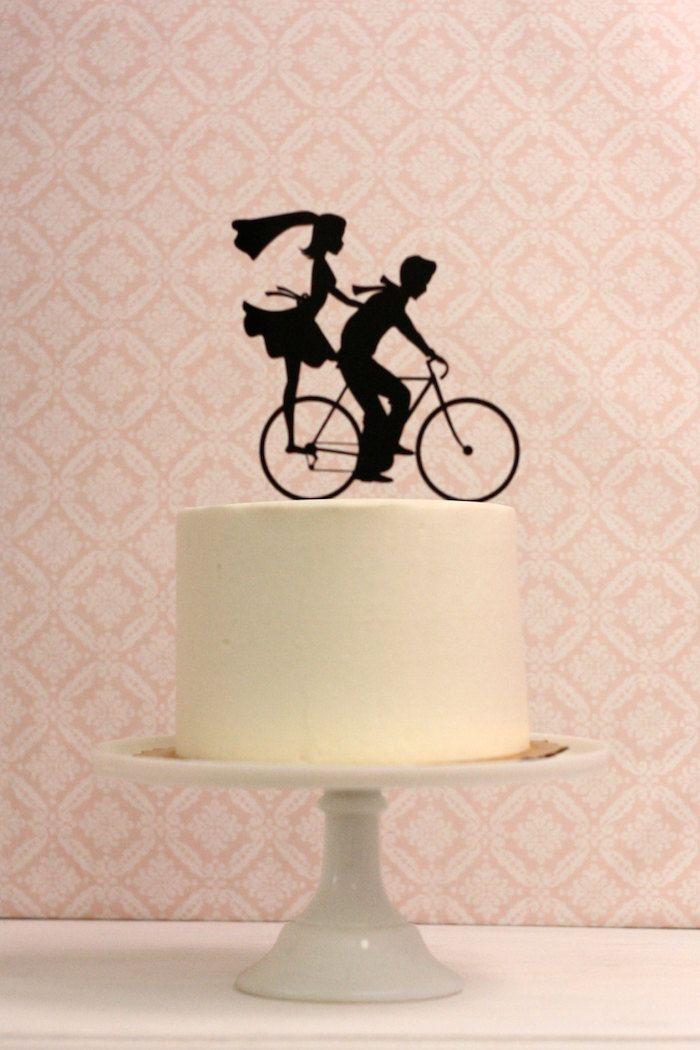 http://weddingsuperb.com/funny-bicycle-wedding-cake-topper/