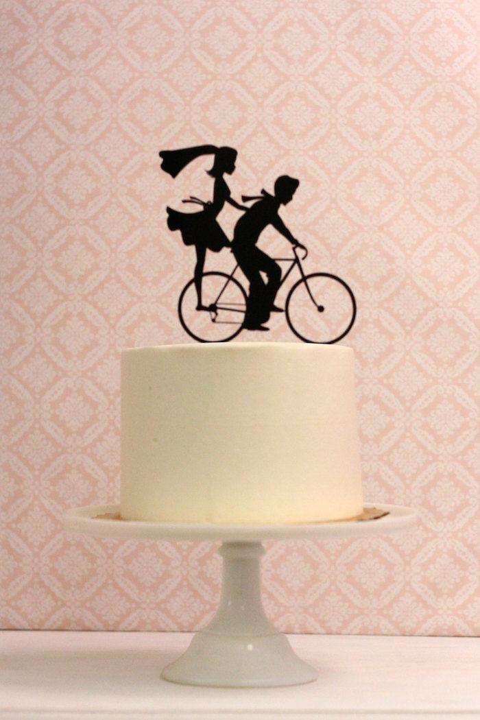 http://weddingsuperb.com/funny-bicycle-wedding-cake-topper/