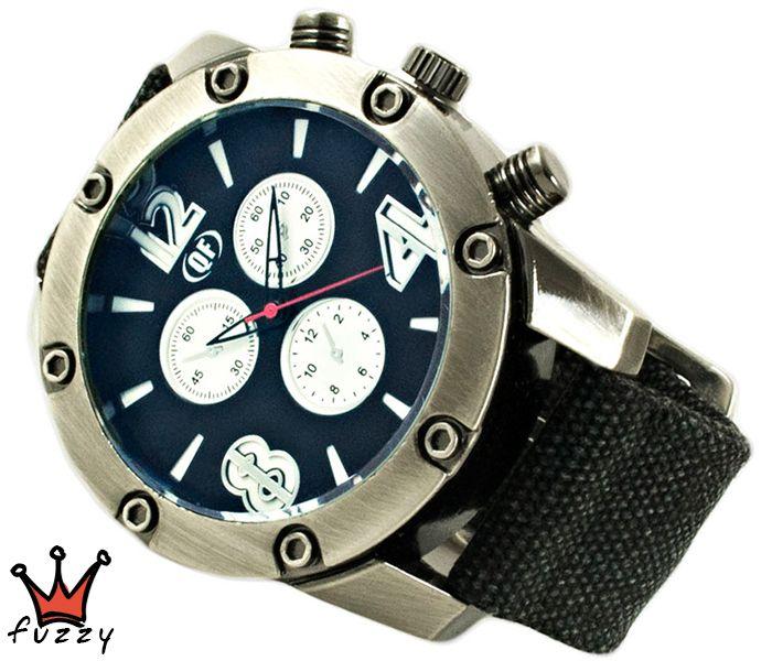 Ανδρικό ρολόι  σε ασημί και μαύρο χρώμα. Λουράκι απο καραβόπανο σε μαύρο. Καντράν 50 mm.