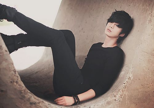 (Closed RP, pretend his eyes are closed lol) Ezra had passed out after another dose of cocaine, completely lost in his own world of nightmares and daydreams. He'd chosen the abandoned skatepark, a usual dosing sight for him, and gotten semi-comfortable in one of the cement skating tunnels, before pushing the needle into his arm. Of course, he didn't hear (Y/C) approach, far away from where he lay, looking handsomely pathetic in the tunnel.