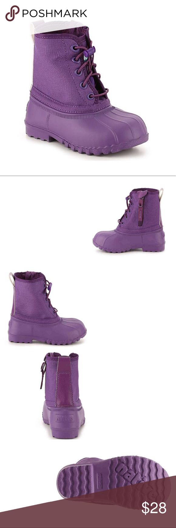 Native Jimmy Girls Toddler - Purple Rain Boots Like new used once DESCRIPTION: Keep her moving and grooving with the Jimmy kids boots from Native. Snow, rain, or sunny skys, the light weight design on this cute and practical duck boot will leave her smiling from ear to ear! FEATURES Printed canvas and Keep It Lite™ EVA upper Side zip closure Drawstring lace-up with toggle closure Washable and water resistant Heel pull tab Massaging nubs on the footbed to stimulate circulation Keep It Lite…