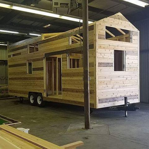 Western Red Knotted Cedar Siding on a 28ft custom tiny house with 3 bedrooms! #tinyhouse #tinyhome #kjetinyhomes #tinyhouseonwheels #tinyhousebuilders #thow #livetiny #minimalist #forsale #custom #tinyhouselayout #tinyhousecommunity #tinyhousemovement #tinyhousetrends #cedar