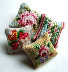 four miniature needlework cushions (links to PDF charts) Might be useful in order to make embroidered broaches?