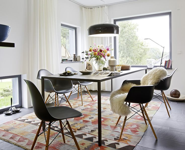 dining room of a modern prefab home notice the how the tall curtains