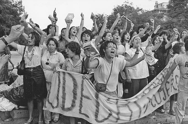 "Women soaked by water cannon during a demonstration against Pinochet on International Women's Day in Santiago in 1985. ""This was the first time the protest came into downtown Santiago, the capital. The women were assaulted by rubber bullets and water cannons, and I was on the receiving end of that as well. We had to carry a handkerchief and some lemons, which helped against tear gas apparently, but you would still get blinded for a few minutes. Julio Etchart"