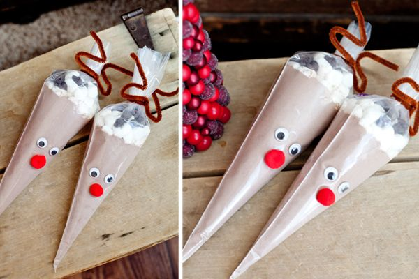These fun and simple hot-chocolate filled reindeer are the perfect craft to make for a Christmas party, great to give out as party favors, and cute gifts for classmates, teachers or coworkers. Materials Needed: Piping bags Hot cocoa powder Mini marshmallows Chocolate chips Brown pipe cleaners Googly eyes Red pompoms Tape Directions: 1. Fill the …