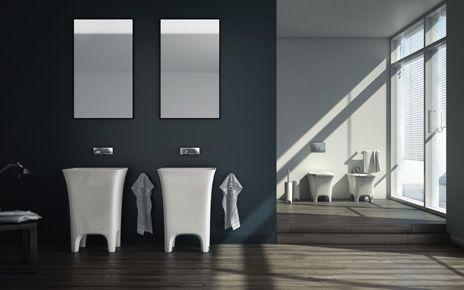 Cow, design Meneghello Paolelli Associati.   lavabo centrostanza e sanitari a terra / Freestanding washbasin and back to wall sanitaries.  #bagno #bathroom #design #black #decor #white #red #sanitaryware #Artceram