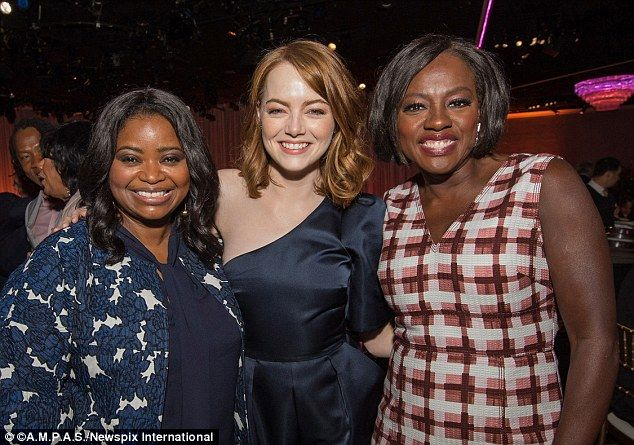 Reunion: Octavia Spencer, Emma Stone and Viola Davis - pictured from left to right - posed for a snap at the 89th Oscar Nominees Luncheon in Beverly Hills on Monday as they had starred in 2011's The Help Together