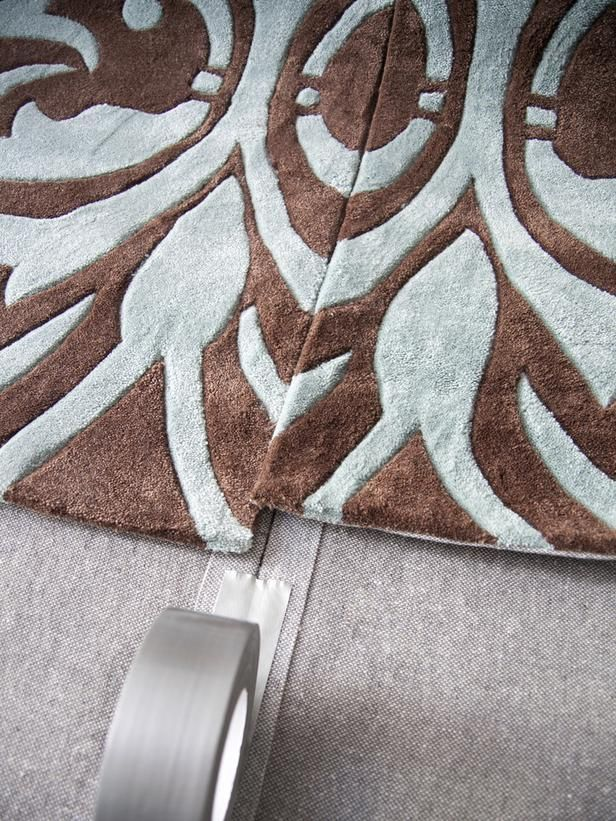 How to turn several small rugs into one large area rug --> http://www.hgtv.com/accessories/how-to-make-one-large-custom-area-rug-from-several-small-ones/index.html?soc=pinterest