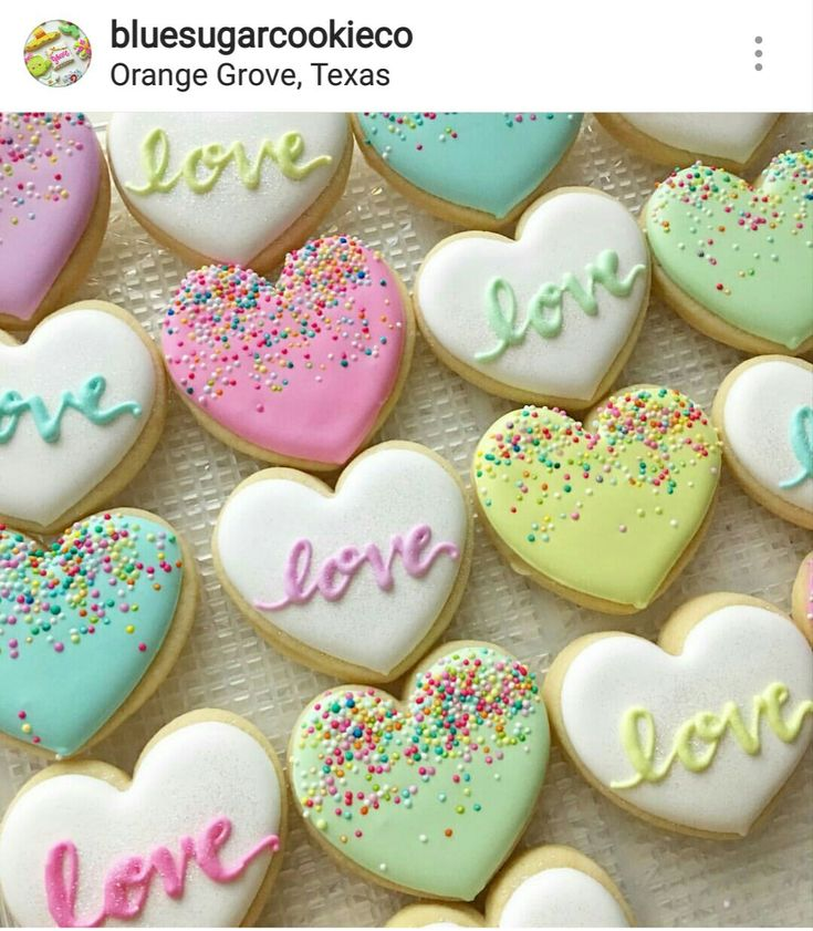 Lovely colored heart cookies: Decorated with royal icing and cookie sprinkles.