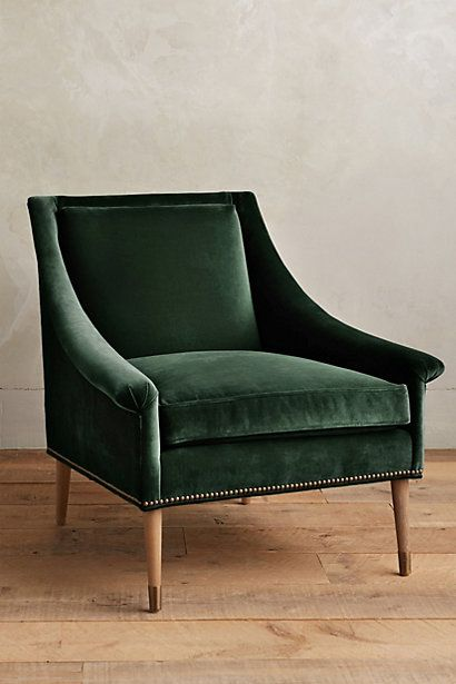 Sexy, swoop arm armchair in deep emerald/forest green velvet.