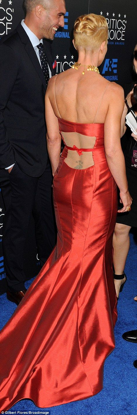 Peek-a-boo: The sheer detailing on the back showed off her back tattoo and accentuated her frame