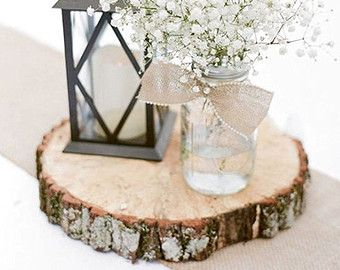 do you have any lanterns?  blk painted log sprinkle with with red and white beads- with candle lantern, wine bottle with babys breath, smaller votive with red candle? red helium ballon # sign