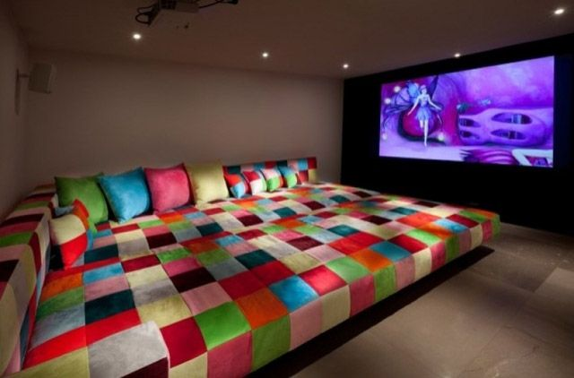 Media Room with couch/bed (two queen or full size upholstered mattresses..and lots of pillows