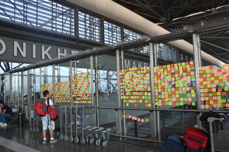 Thessaloniki Macedonia Airport Departure Hall - Post-it greetings from travellers.