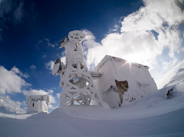 GREECE CHANNEL | Photographer Voreas captured these striking images of an abandoned building completely consumed by snow and ice after climbing Mount Ossa (also known as Kissavos) in the Thessaly region of Greece. The building, described by some Flickr users (not surprisingly) as an ice-house and by others as the 'refuge', is attached to a small tower structure and may have served as a scientific research station.