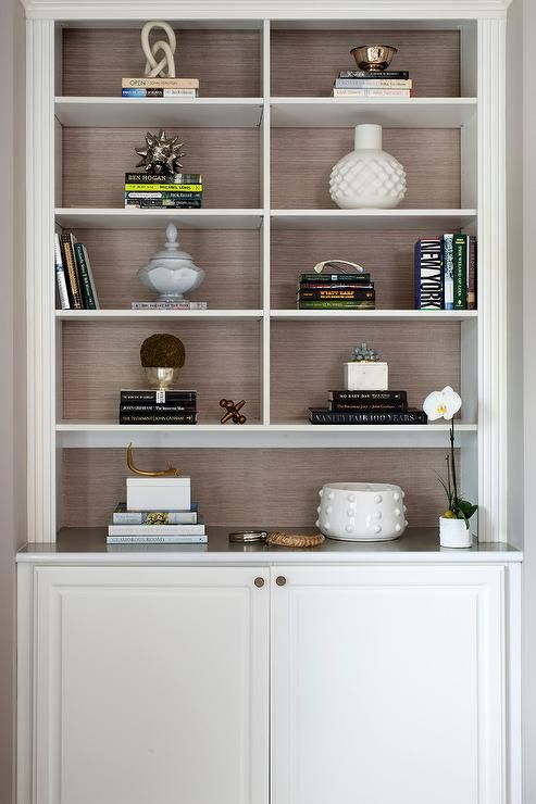 Styled Light Gray Built In Living Room Shelves Are Accented With A Taupe  Grasscloth Back Part 88