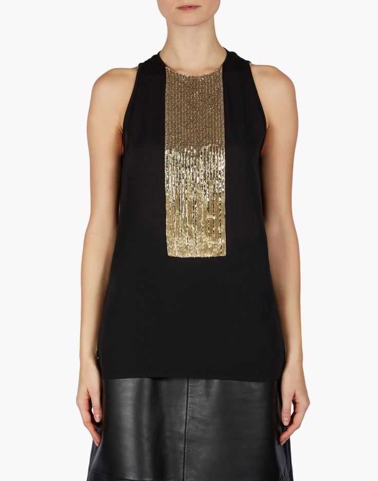 Eye-catching gold beading turns a simple black sleeveless top into a spectacular piece for wearing with a black leather skirt, pants and Dsquared2's gold strappy sandals.