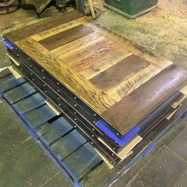 We made several reclaimed barn oak table tops for this project.
