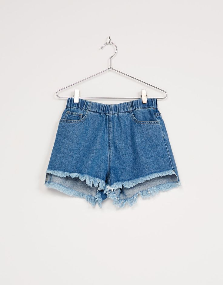 Denim shorts with frayed elastic waist. Discover this and many more items in Bershka with new products every week