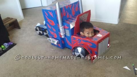 My 7 year old son wanted to be Optimus Prime this year, and I embraced the challenge! We used cardboard boxes and made several trips back to the store...